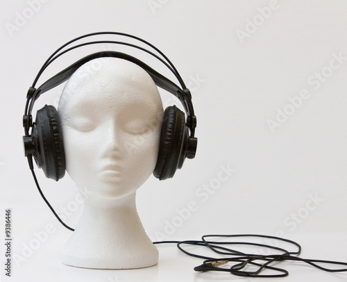 Mannequin wearing DJ headphones on white - 9386446