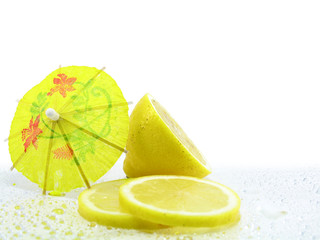 Sliced and Halved Lemons decorated with cocktail umbrella