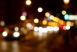 Out of focus lights of a street at night