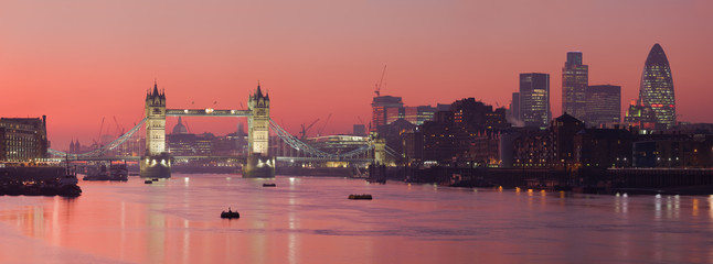 Tower Bridge and city of London with deep red sunset © David Iliff