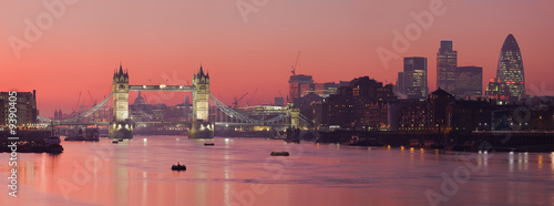 Tower Bridge and city of London with deep red sunset Photo by David Iliff
