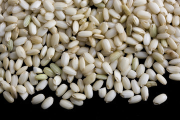 Sweet brown rice on black background