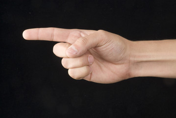 Hand signal in a black back