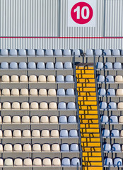 Empty tribunes and footsteps on a football stadium