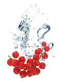 red currant is dropped into water
