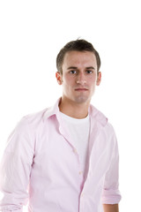 A young man dressed casually in a pink shirt