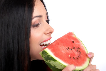 Beautiful young woman eating the water melon.