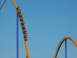 People riding on a big roller coaster.