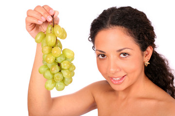 A smiling woman holds a bunch of green grapes