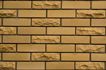 yellow brick wall of city house