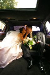Kiss of a newly-married couple in car