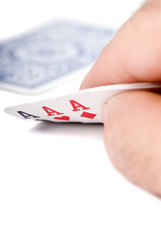 A card player looks at 3 Aces with one card down.