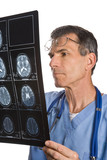 Physician reading and reviewing a MRI brain scan poster