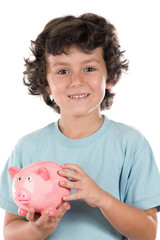 Adorable boy with pink piggy bank in his hands isolated