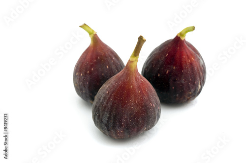 three purpel brazil figs isolated on white