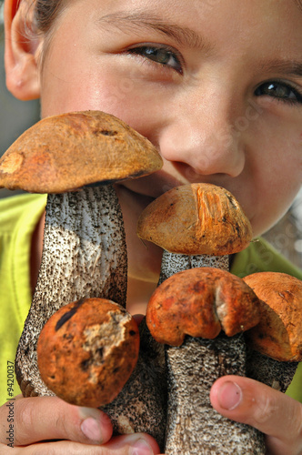 The girl holds in hands some fresh aspen mushrooms