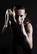 roleta: woman running over dark background