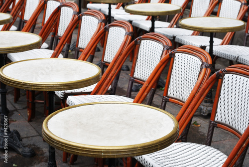 rows of wicker chairs and round tables