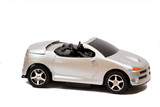 Isolated toy convertable silver car poster