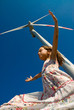 girl in the wind under a turbine