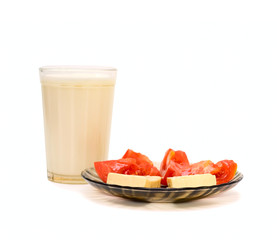 Glass with milk and plate with food isolated on white