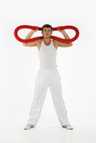 Young man with gym apparatus poster