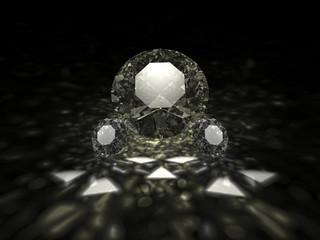 A three sparkling brilliant cut diamonds on dark background