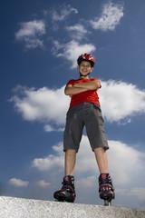 boy on the rollerblades, blue sky background