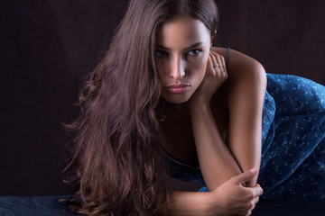 beautiful woman portrait, leaned on the table
