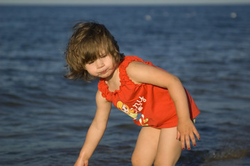 sweet little girl on the beach. summertime