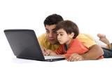Parents having fun using the Laptop . poster