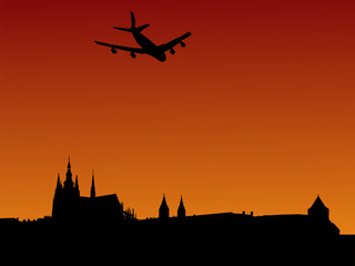 Plane arriving in Prague with St Vitus cathedral and castle