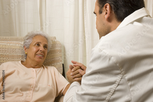Male doctor with elderly woman patient