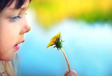 Fototapety Cute girl with dandelion, focus on dandelion