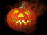 A scary old jack-o-lantern on black... poster