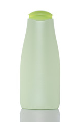 Bottle with soap or shampoo reflected on white background