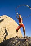 Hoop dancer performing in the California desert, poster