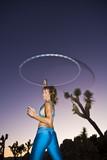 Hoop dancer performing in the California desert. poster