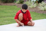 Boy in his driveway playing with chalk poster
