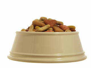Pile of dog biscuits in a china bowl