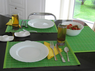 Ready to breakfast table in the green colours.