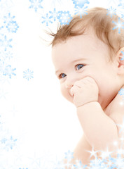 bright portrait of adorable baby with snowflakes