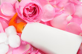 Blank skin care lotion with rose petals and cotton swabs poster