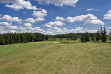 fairway of a beautiful golf course with dramatic summer sky