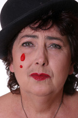 portrait of an actress performing sad  clown