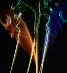 abstract colored smoke in a black background