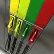 3D rendering of four brightly colored gas pumps 3