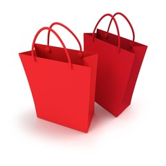 Duo of red shopping bags against a white background