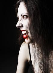 portraite sexy vampire-girl on black background