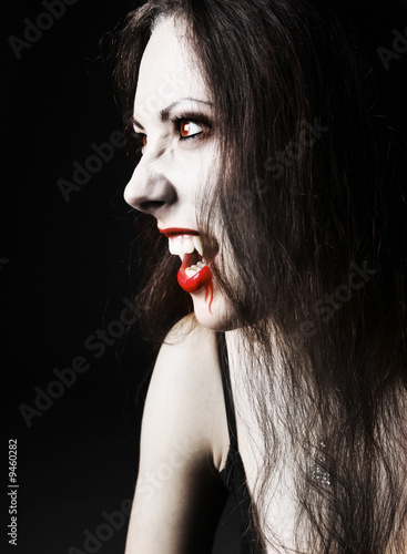 portraite sexy vampire-girl on black background